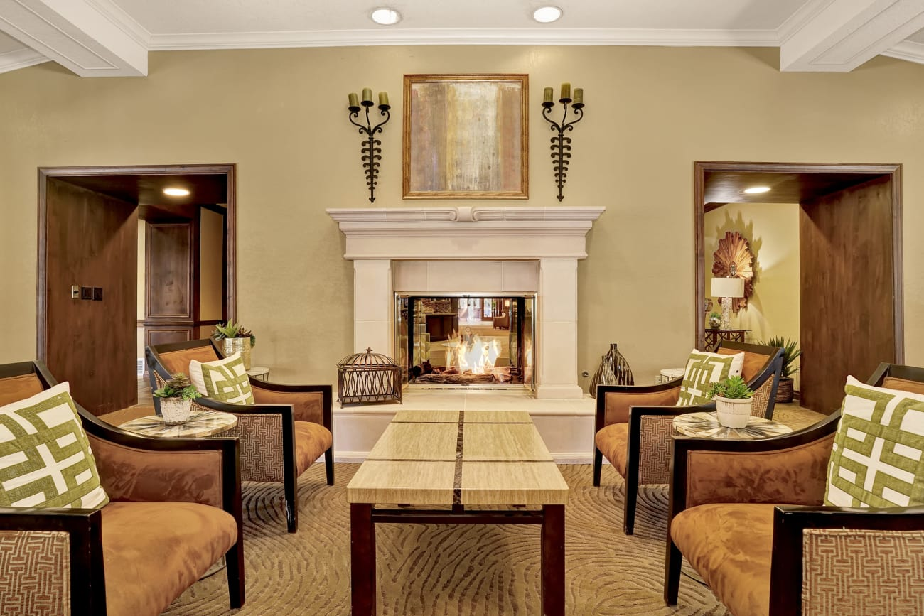 A fireplace and ample seating at The Country Club of La Cholla in Tucson, Arizona