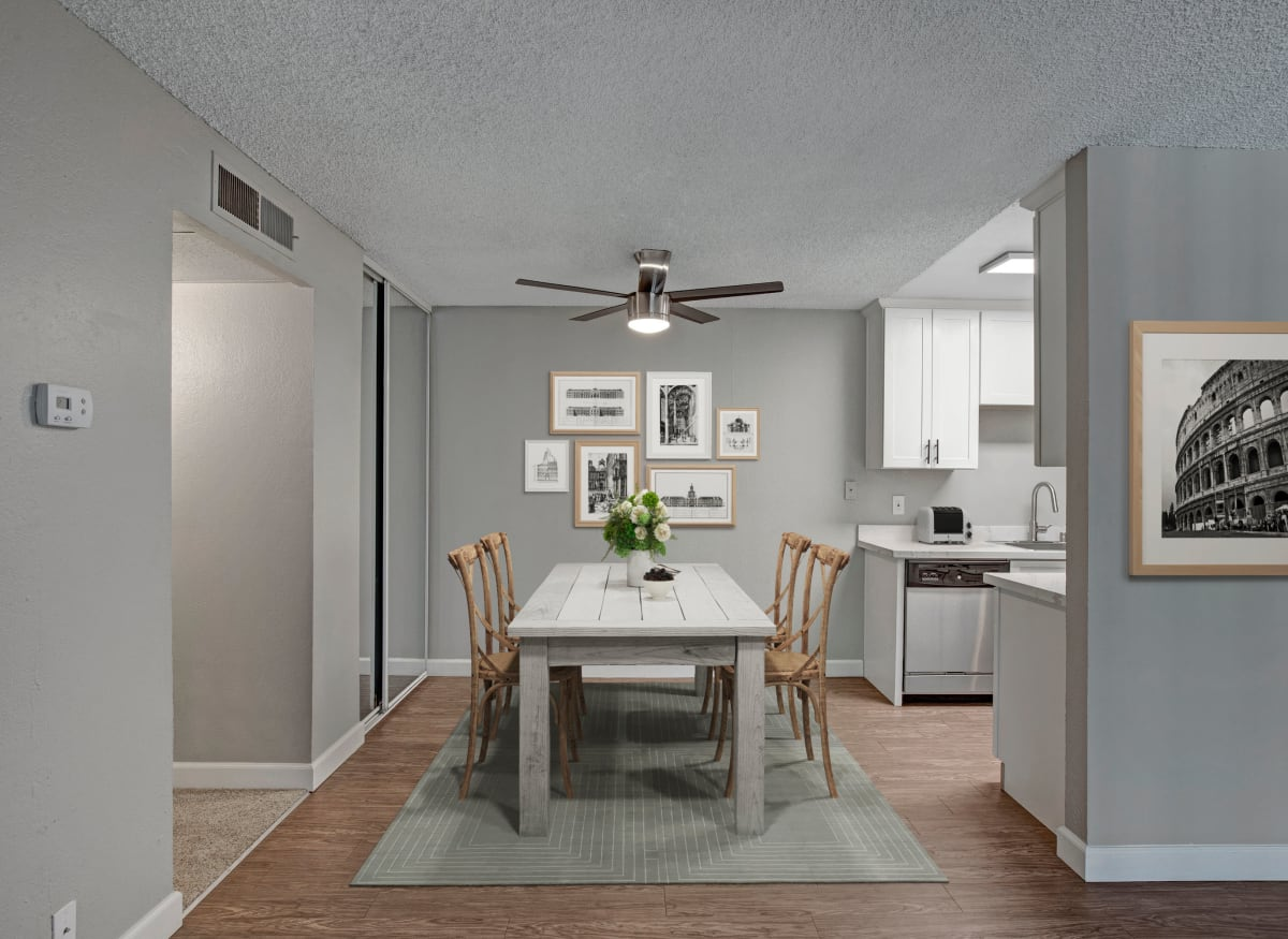 Spacious living room and dining table in model apartment home of The Archer in Sacramento, California