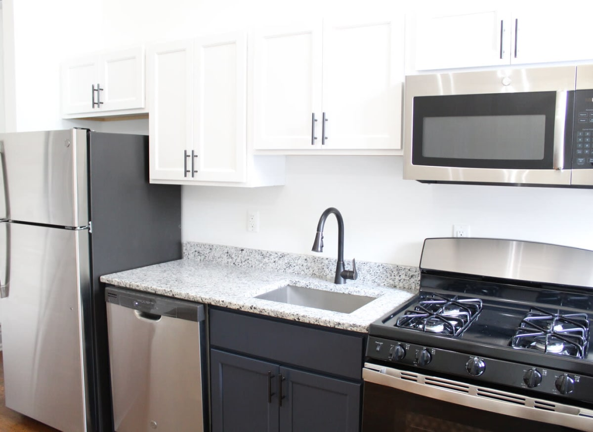 Model kitchen with new stainless steel appliances at The Maven @ 806 in Louisville, Kentucky