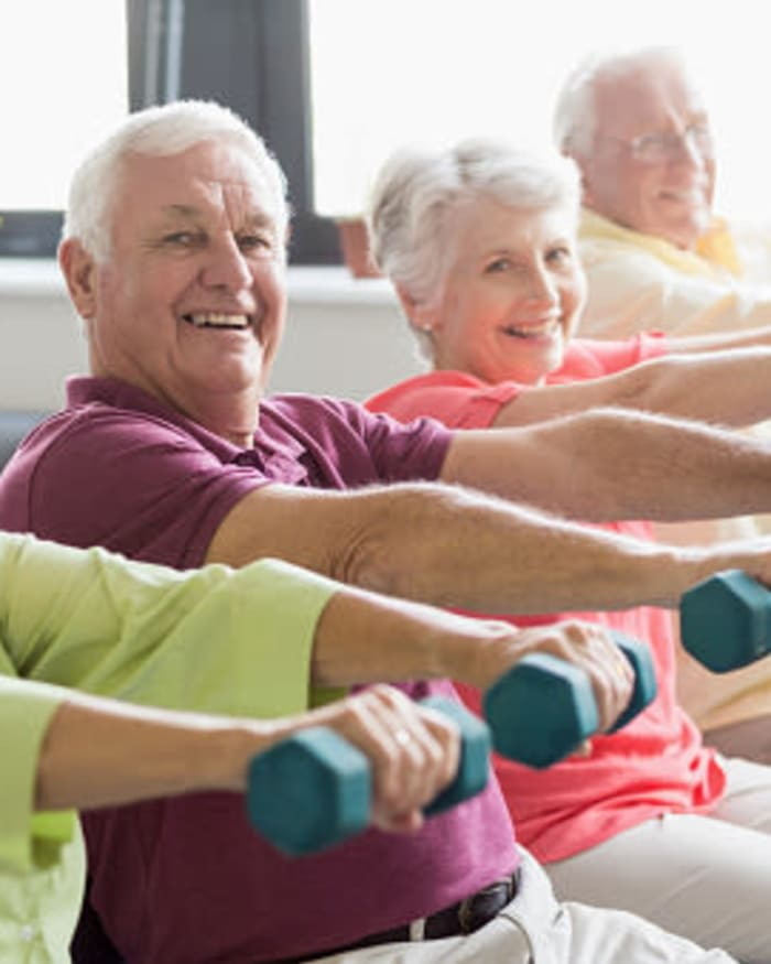 Residents enjoying fitness class at The Springs at Whitefish in Whitefish, Montana.