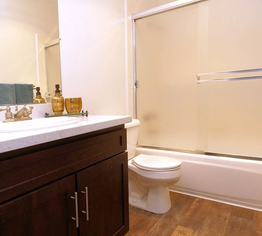 Bathroom with a large oval tub at La Valencia Apartment Homes in Campbell, California