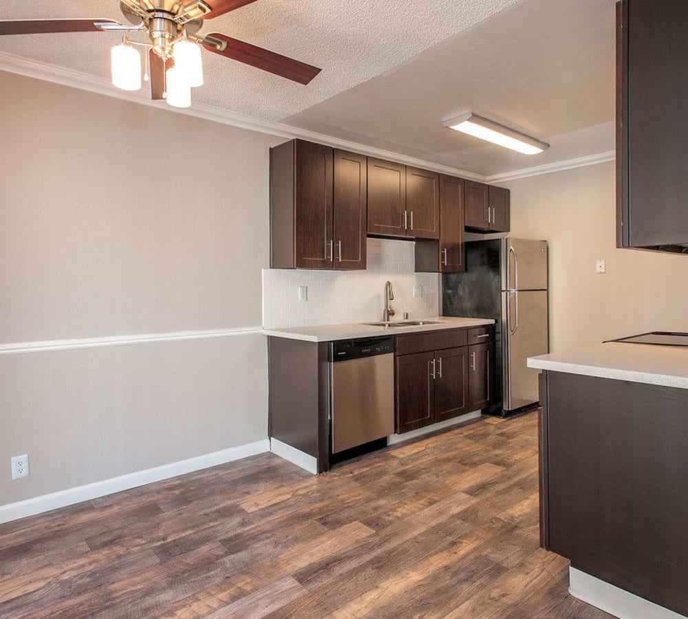 Kitchen with wood-style flooring and cabinets at La Valencia Apartment Homes in Campbell, California