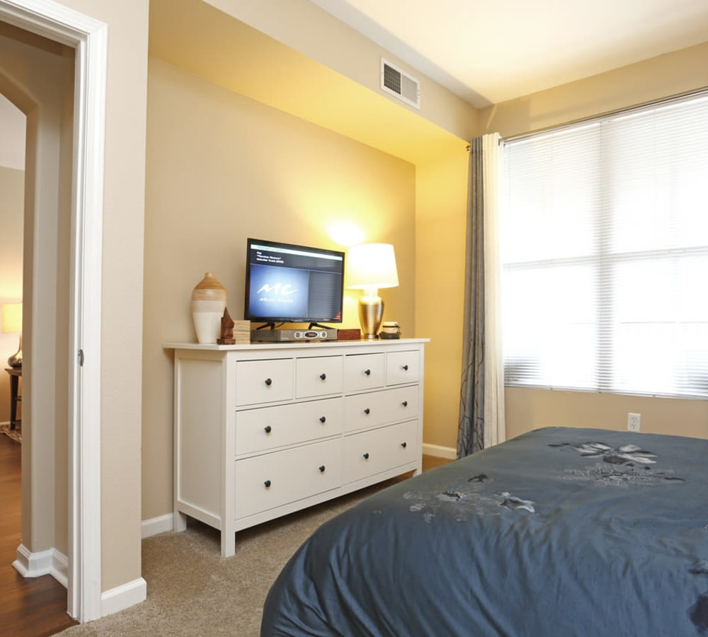 Spacious master bedroom with a large window at Park Central in Concord, California