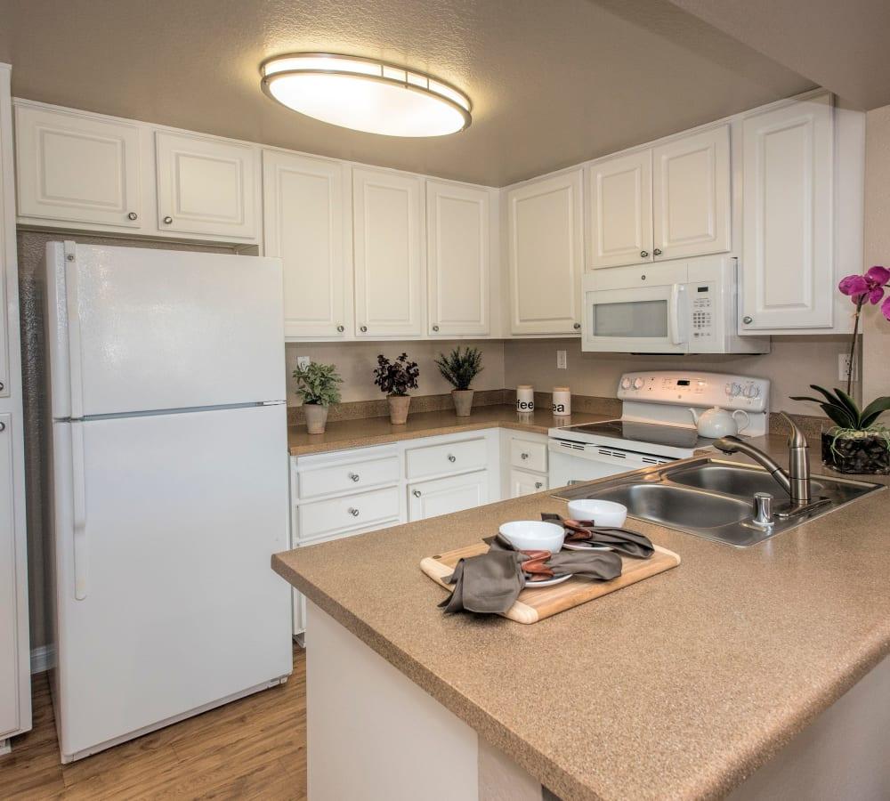 Spacious kitchen with white appliances at Hidden Hills Condominium Rentals in Laguna Niguel, California