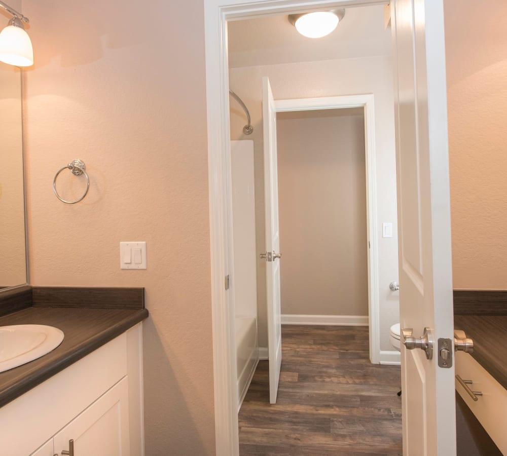 Main bathroom with wood-style flooring at Hidden Hills Condominium Rentals in Laguna Niguel, California