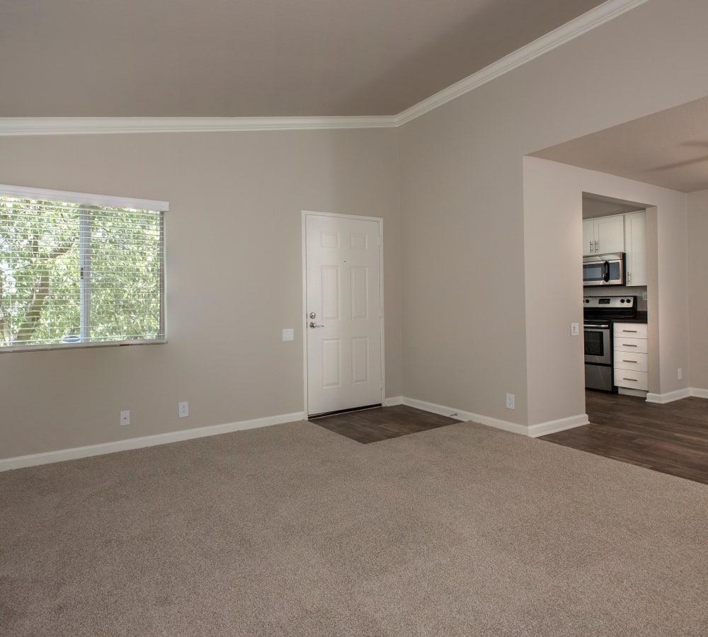 Spacious living room with plush carpeting at Hidden Hills Condominium Rentals in Laguna Niguel, California