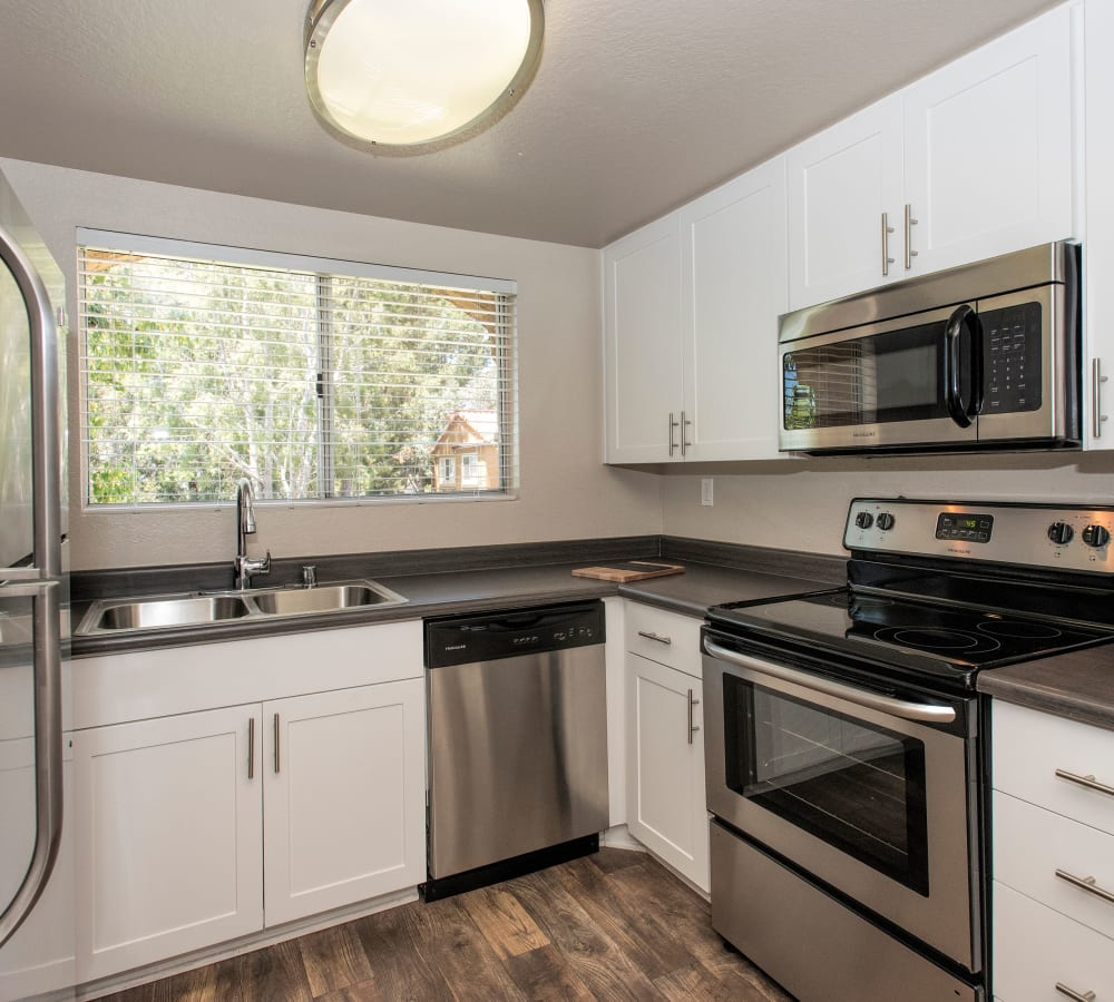 Luxury kitchen with a large window and plenty of counter space at Hidden Hills Condominium Rentals in Laguna Niguel, California