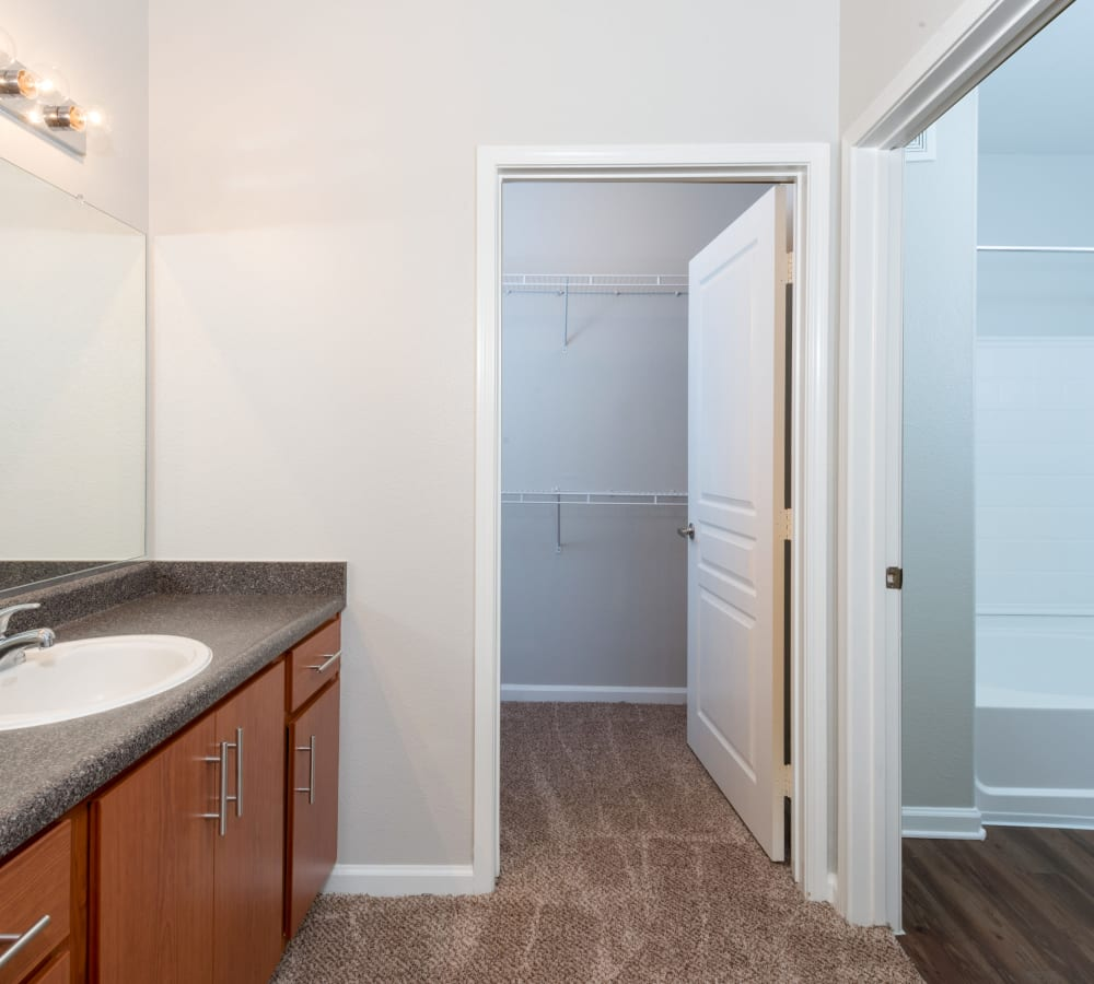 Main bathroom with a large vanity  mirror at The Artisan Apartment Homes in Sacramento, California