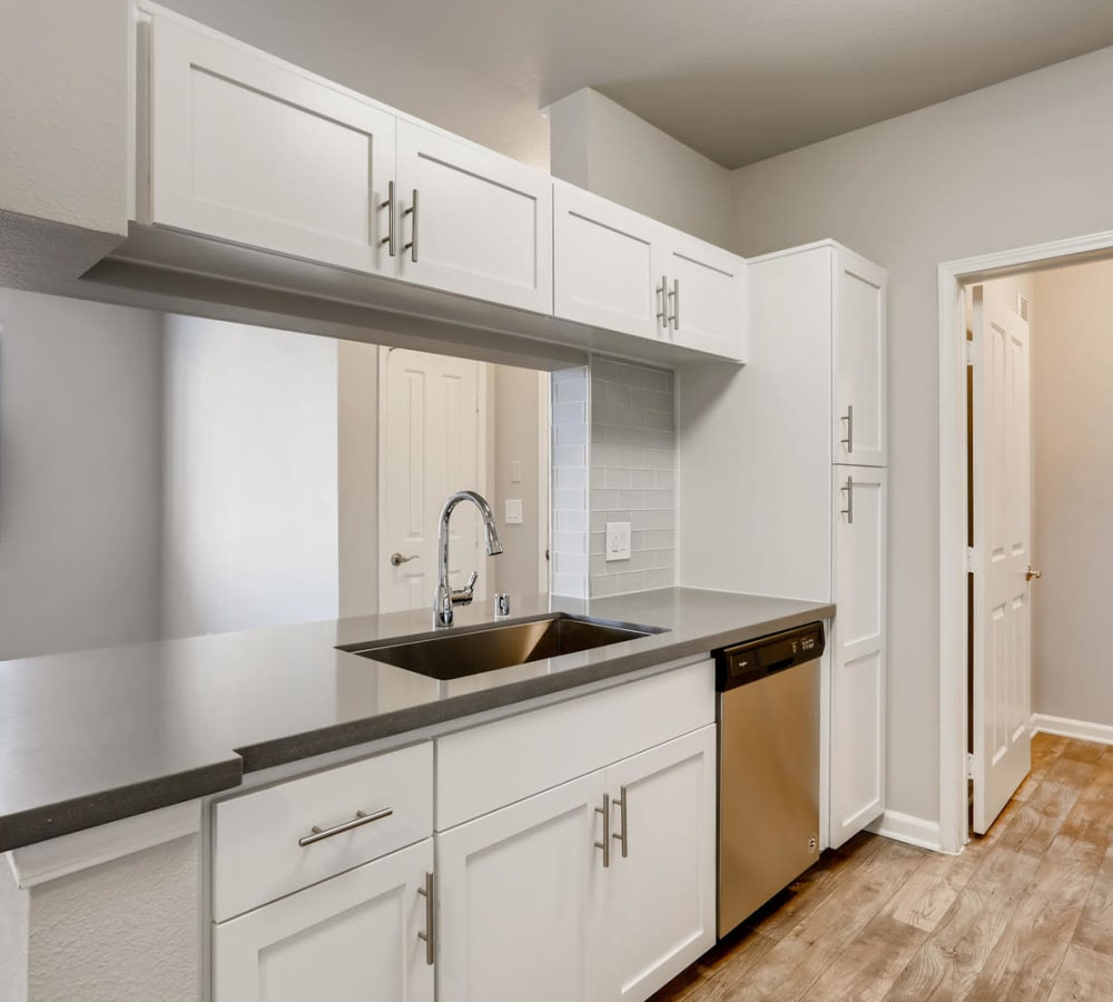 Kitchen with a pass-through window at Alize at Aliso Viejo Apartment Homes in Aliso Viejo, California