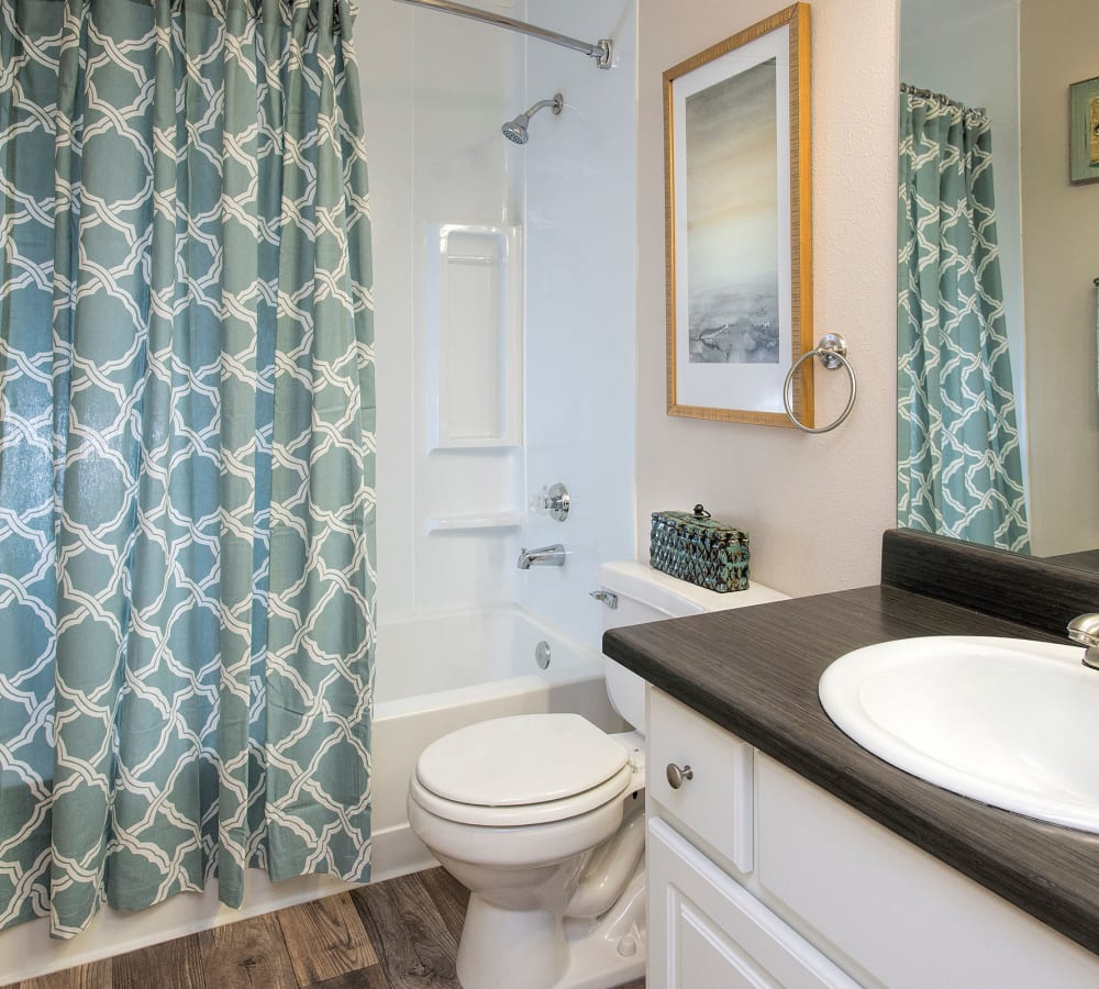Bathroom with an oval tub shower at Slate Ridge at Fisher's Landing Apartment Homes in Vancouver, Washington