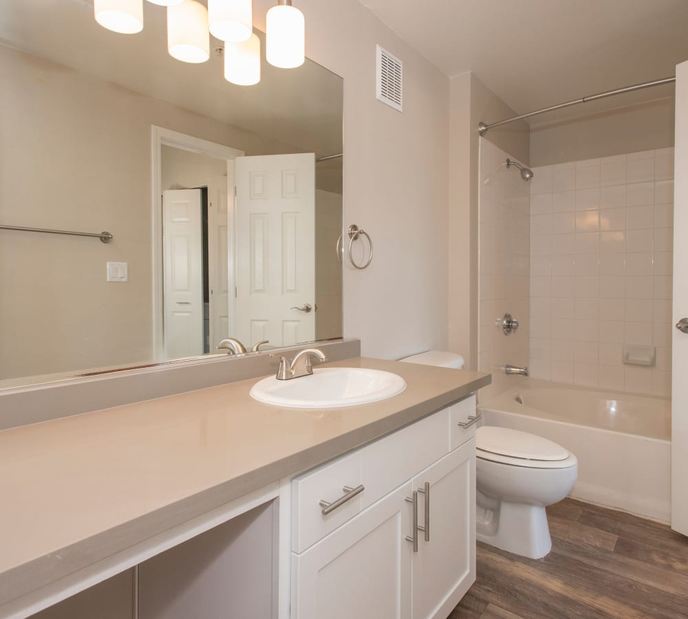Bathroom with a large counter-top at The Vintage at South Meadows Condominium Rentals in Reno, Nevada