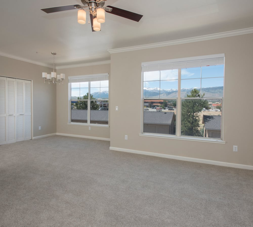 Spacious living room with a ceiling fan at The Vintage at South Meadows Condominium Rentals in Reno, Nevada