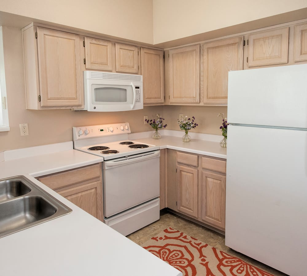 Kitchen with white-appliances at The Vintage at South Meadows Condominium Rentals in Reno, Nevada
