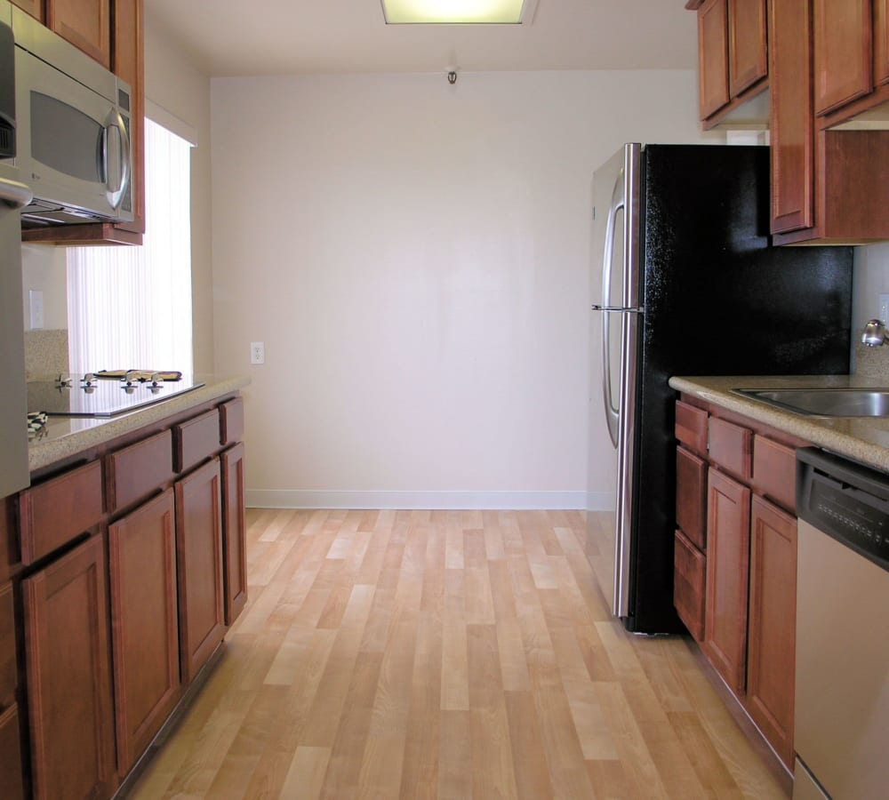 Spacious kitchen with plenty of counter space and stainless-steel appliances at Tower Apartment Homes in Alameda, California