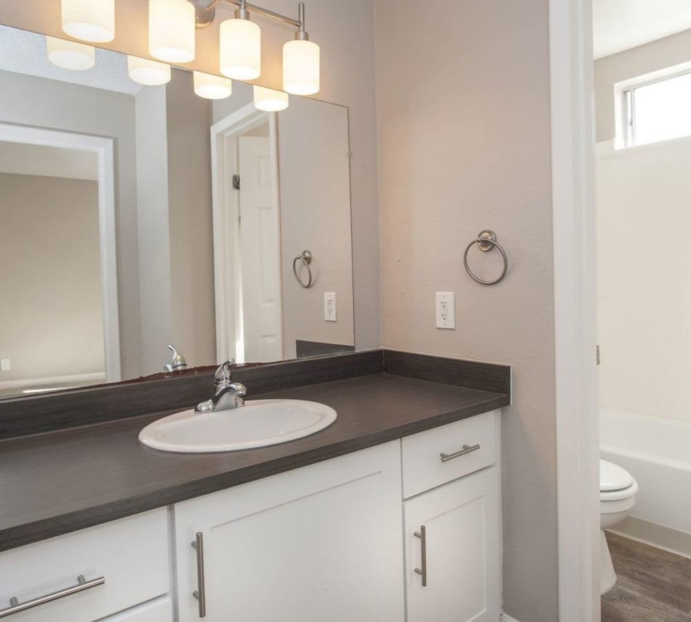Bathroom with a large vanity at Flora Condominium Rentals in Walnut Creek, California