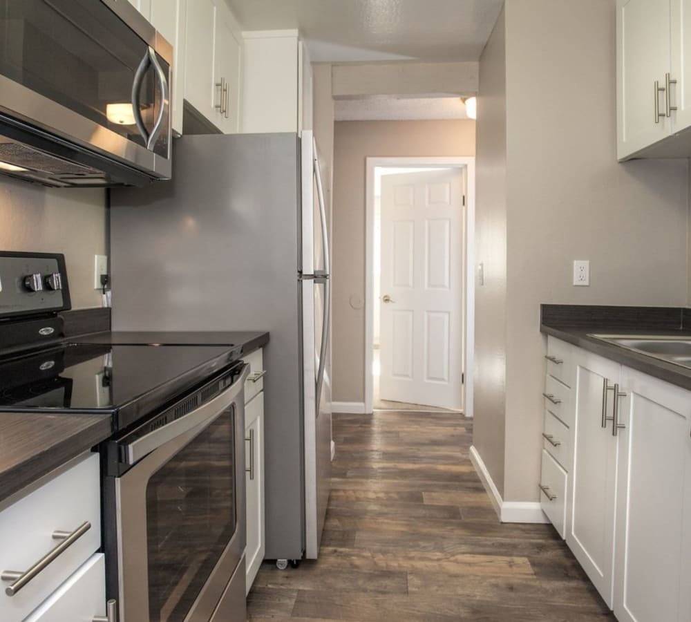 Kitchen with stainless-steel appliances and plenty of counter space at Flora Condominium Rentals in Walnut Creek, California