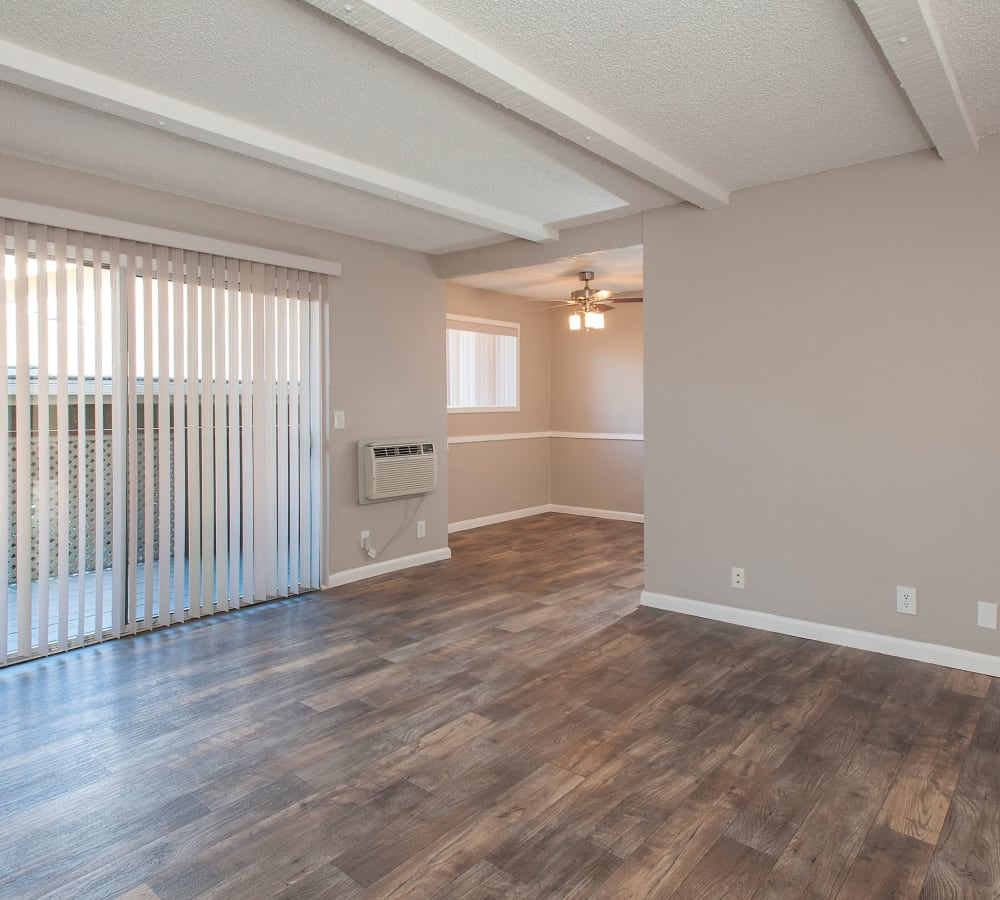 Spacious living room with wood-style flooring at Shadow Oaks Apartment Homes in Cupertino, California