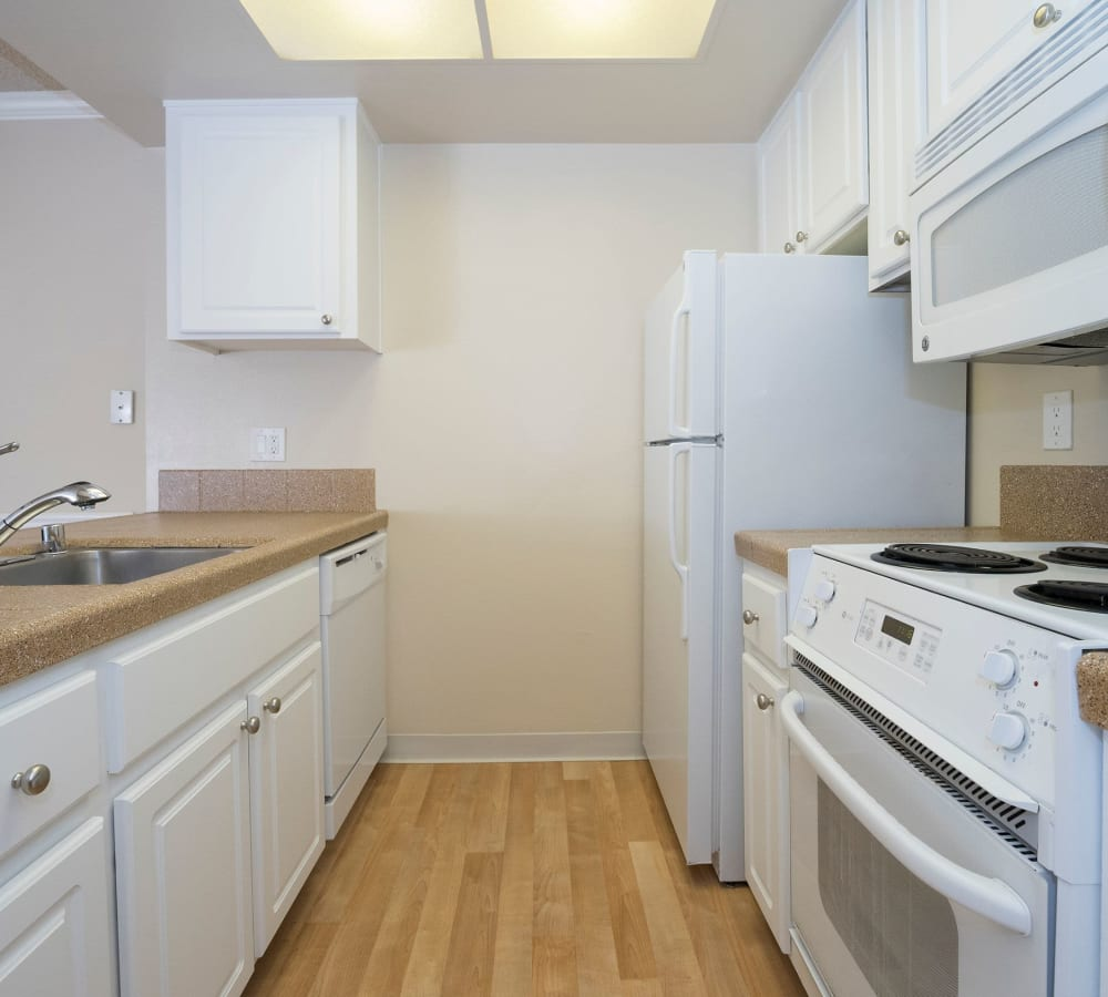Kitchen with plenty of cabinet space at Valley Ridge Apartment Homes in Martinez, California