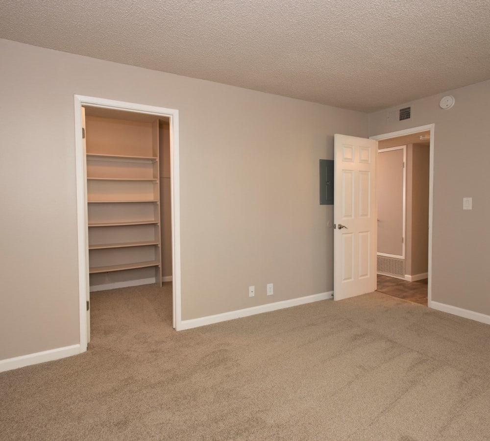 Bedroom with a walk-in closet at Valley Ridge Apartment Homes in Martinez, California
