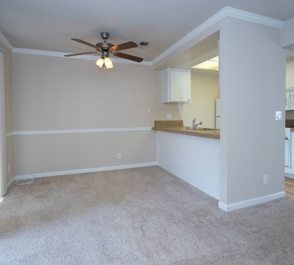 Dining room with a ceiling fan and plush carpeting at Valley Ridge Apartment Homes in Martinez, California