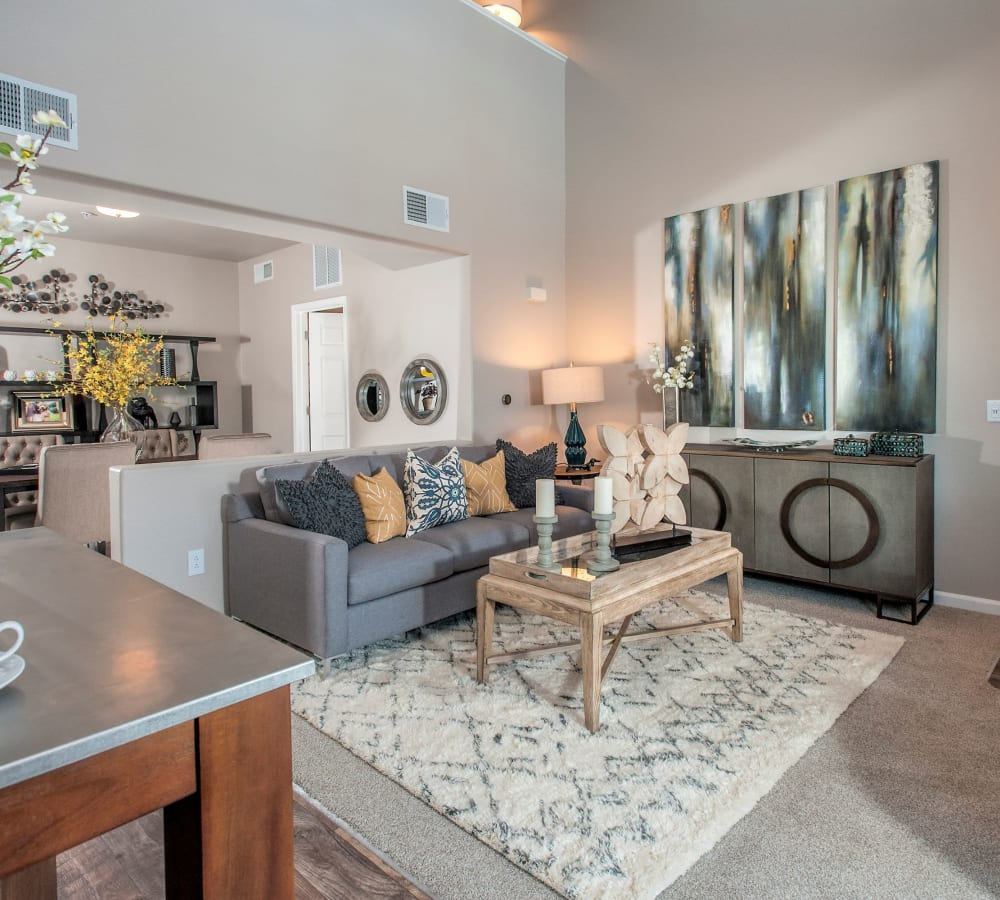 Spacious living room with wood-style flooring and high ceilings at Venu at Galleria Condominium Rentals in Roseville, California