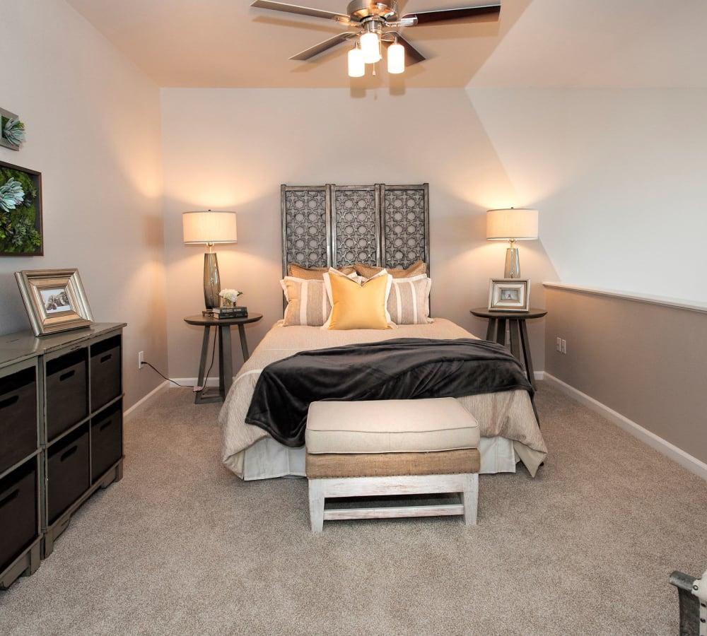 Spacious master bedroom with ceiling fan at Venu at Galleria Condominium Rentals in Roseville, California