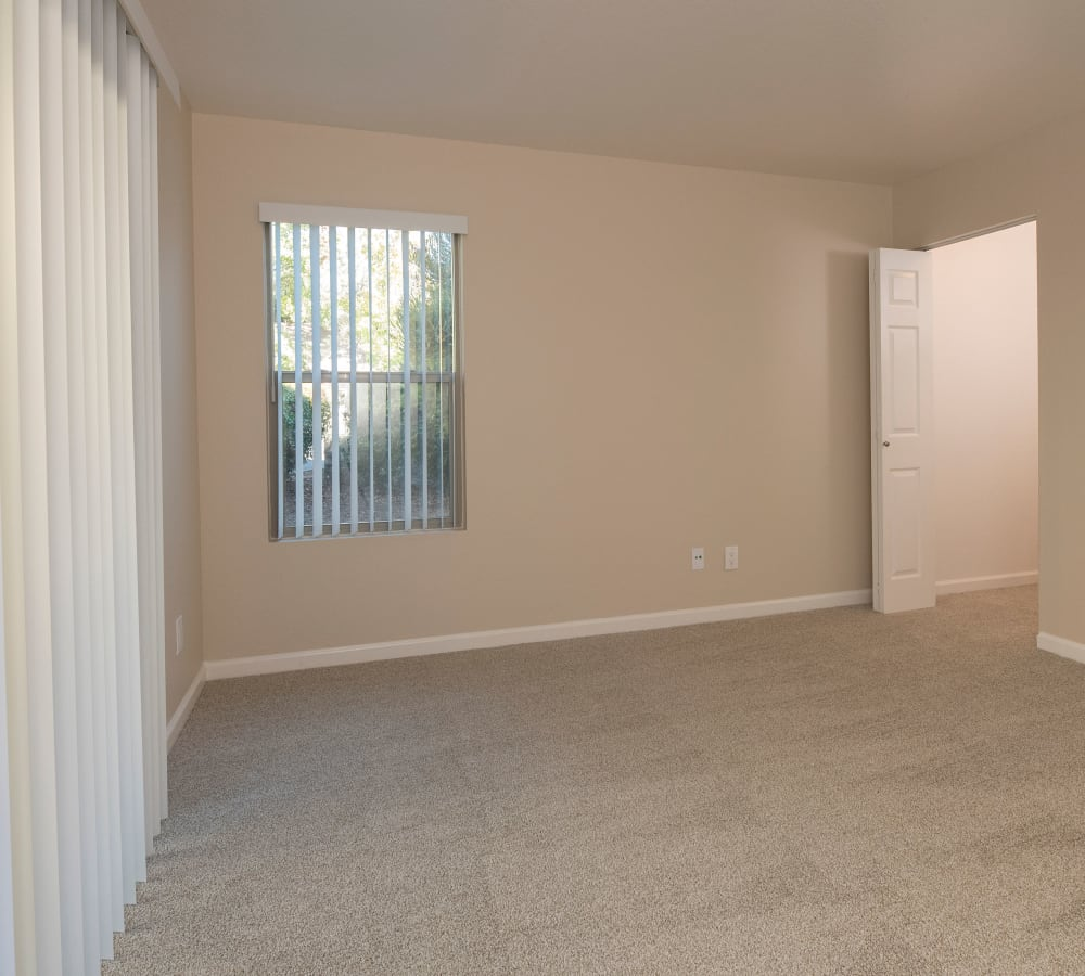 Bedroom with plush carpeting at Sterling Heights Apartment Homes in Benicia, California