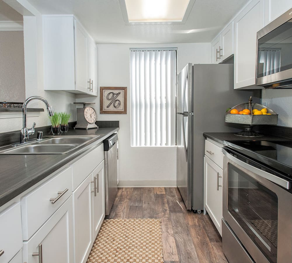 Luxury kitchen with stainless-steel appliances at Sandpiper Village Apartment Homes in Vacaville, California