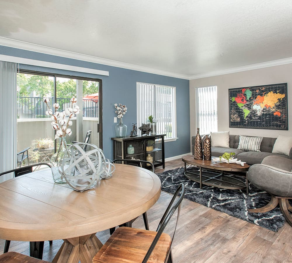 Living room with patio access at Sandpiper Village Apartment Homes in Vacaville, California
