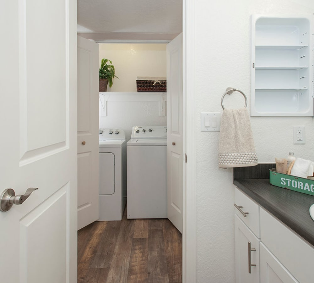 Bathroom with a washer and dryer at Sandpiper Village Apartment Homes in Vacaville, California