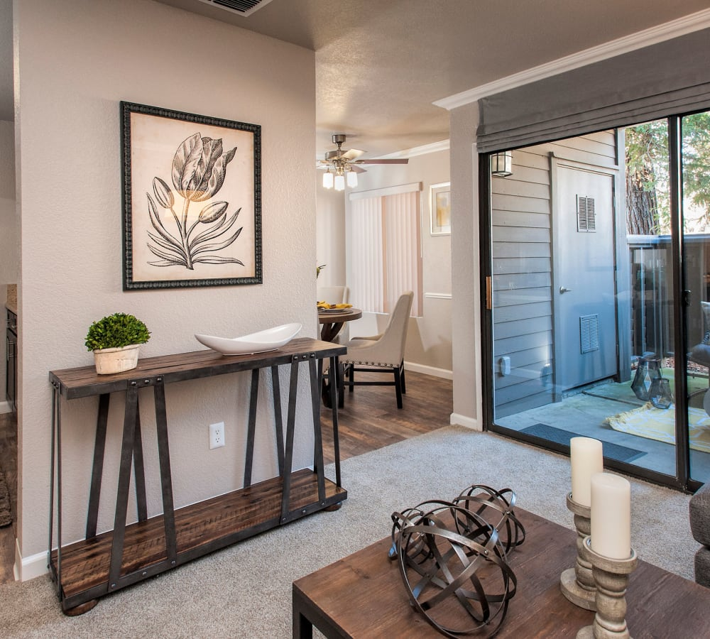 Decorated living space leading out to a private patio at Deer Valley Apartment Homes in Roseville, California