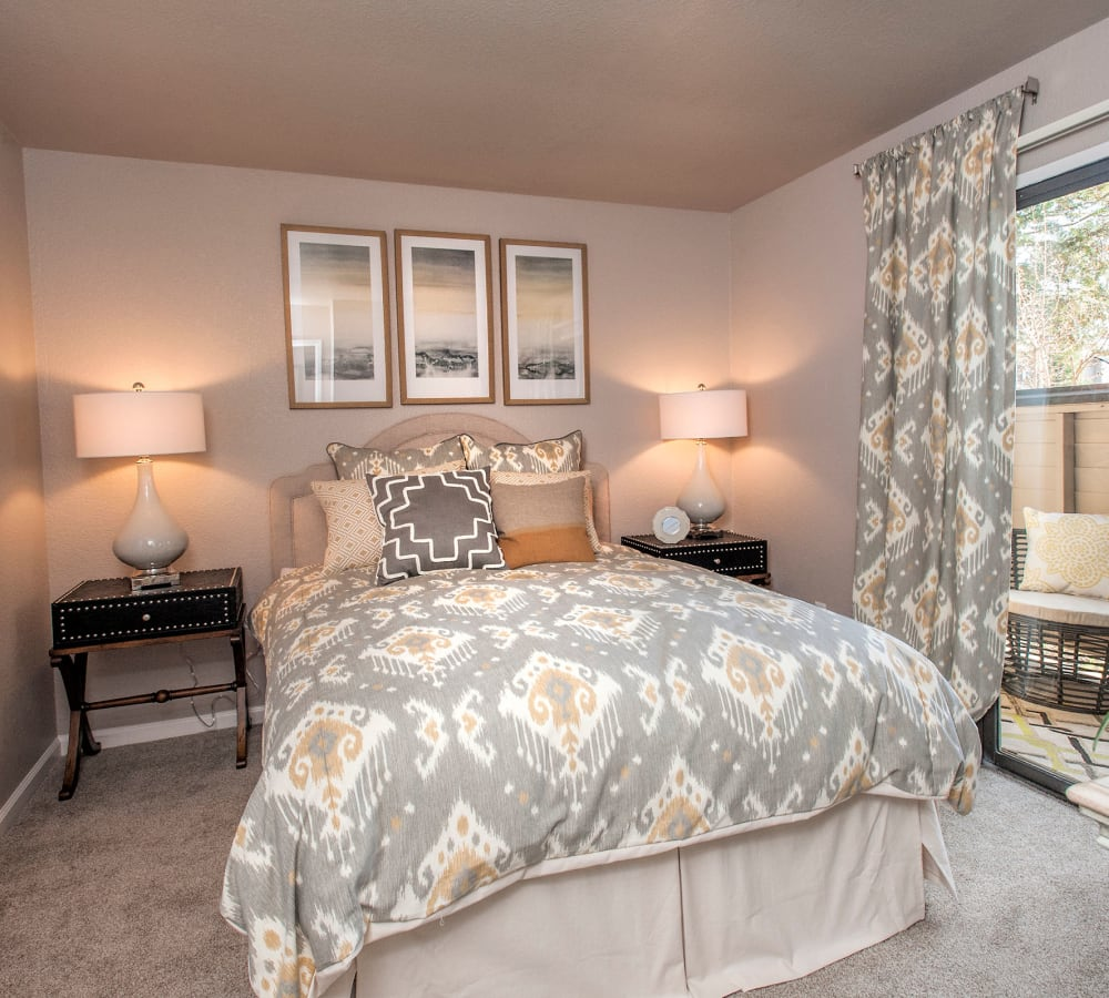 Spacious bedroom with access to a private patio at Deer Valley Apartment Homes in Roseville, California