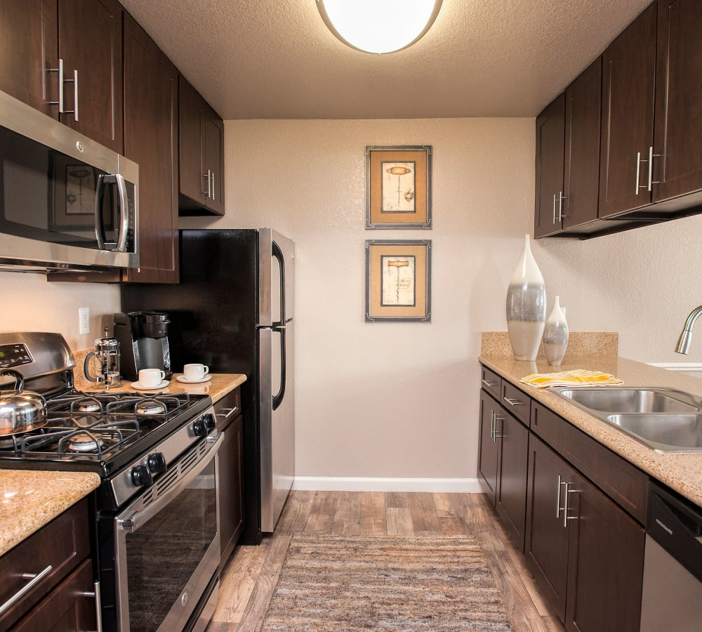 Spacious kitchen with modern espresso cabinetry at Deer Valley Apartment Homes in Roseville, California
