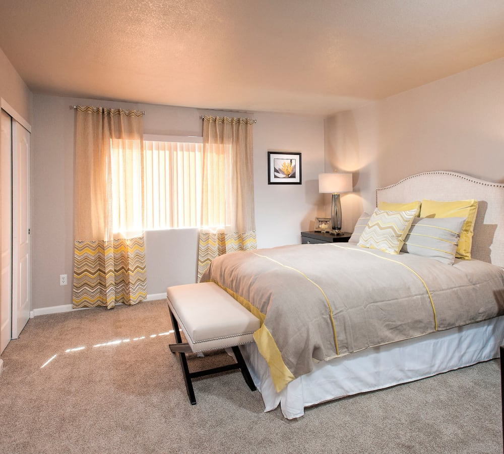 Large master bedroom with soft plush carpeting at Deer Valley Apartment Homes in Roseville, California