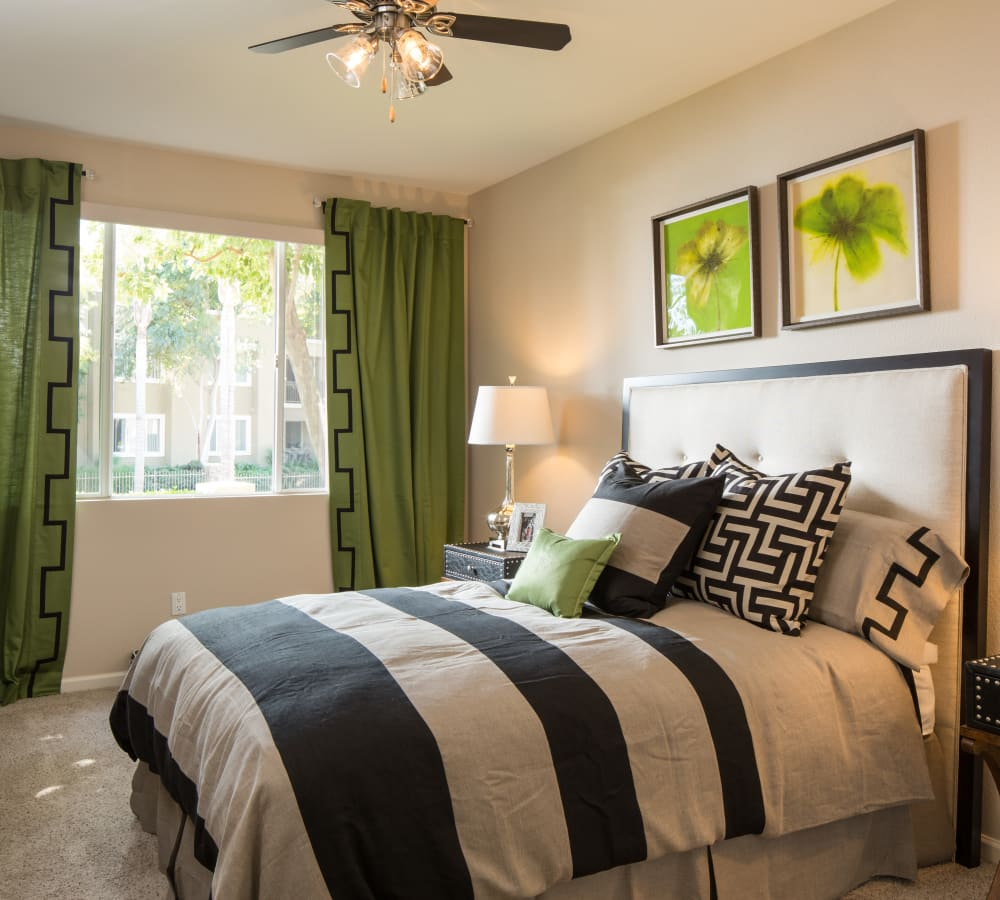 Main bedroom with plush carpeting at Alicante Apartment Homes in Aliso Viejo, California