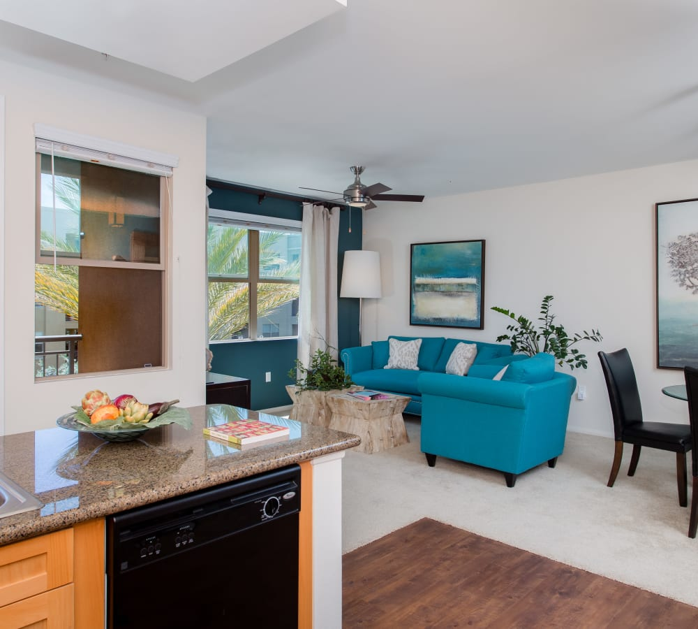 Living room with large windows at Paragon at Old Town in Monrovia, California