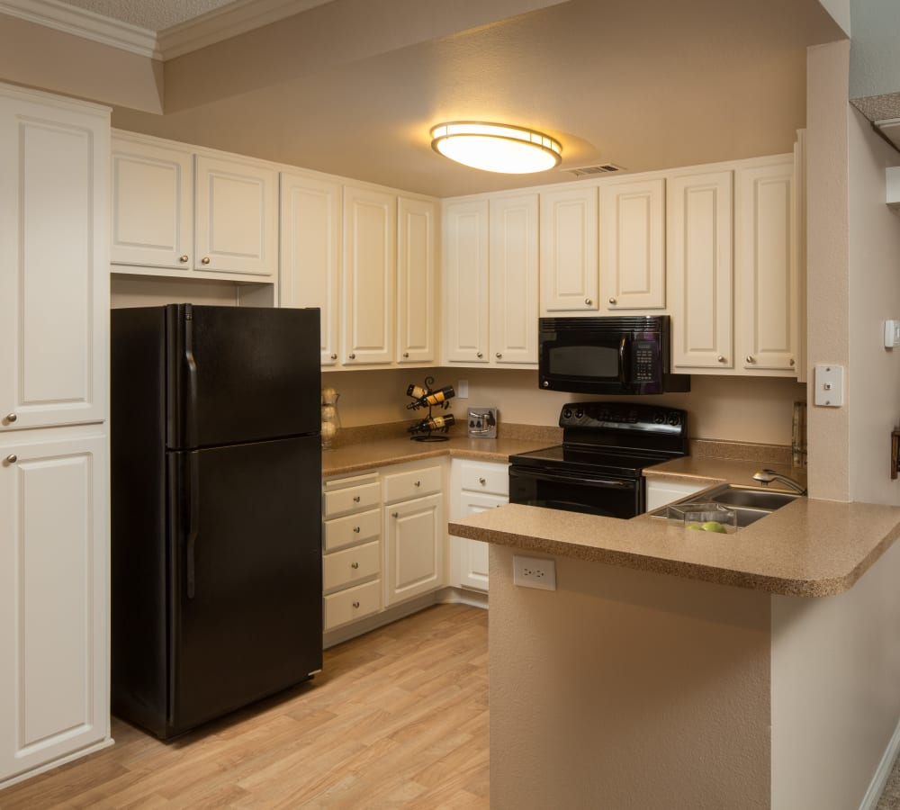 Kitchen with plenty of white cabinets at Paloma Summit Condominium Rentals in Foothill Ranch, California