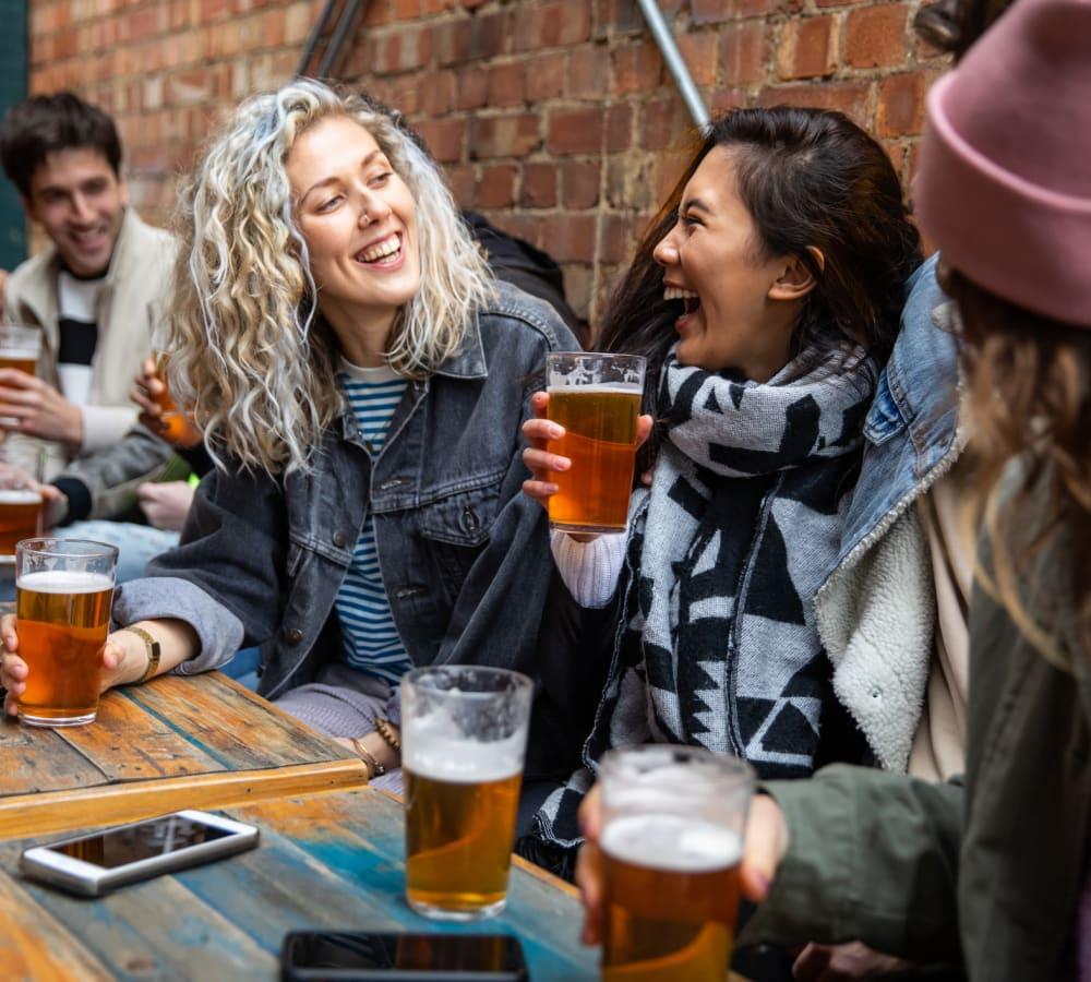 Friends enjoying beer together in Glen Burnie, Maryland near Glen Hollow Apartments