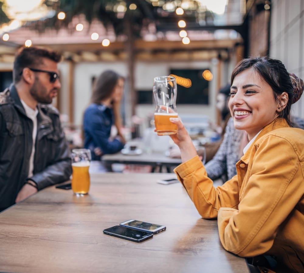 Woman enjoying a beer in Laurel, Delaware near Hollybrook Farms Apartments