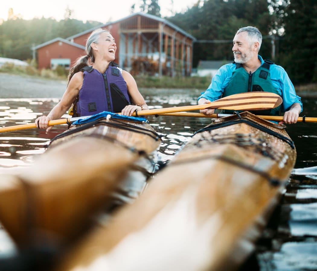 A couple enjoying a kayak tour at Orchard Hills Senior Apartments in Thornton, Colorado