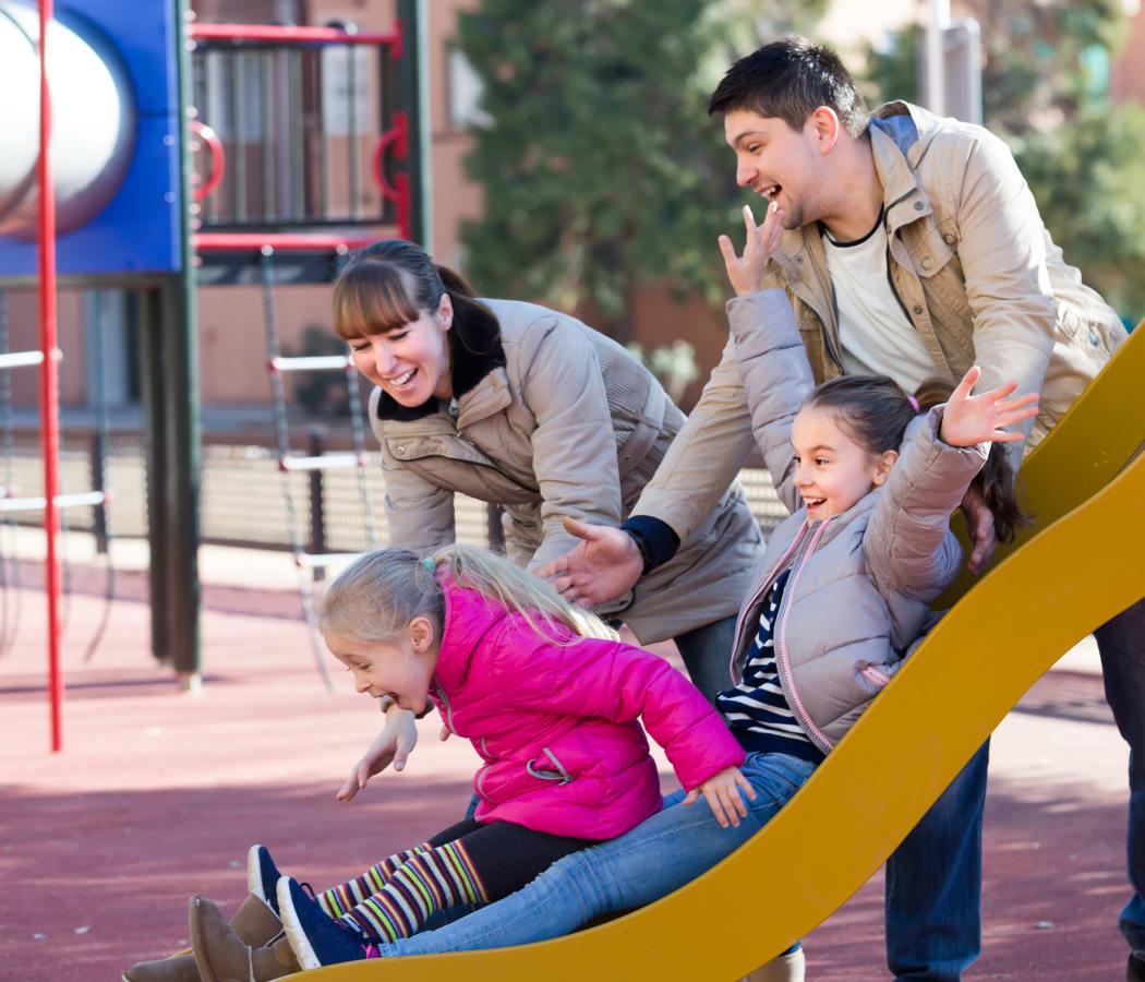 Family at playground at Brandywyne Village in East Boston, Massachusetts