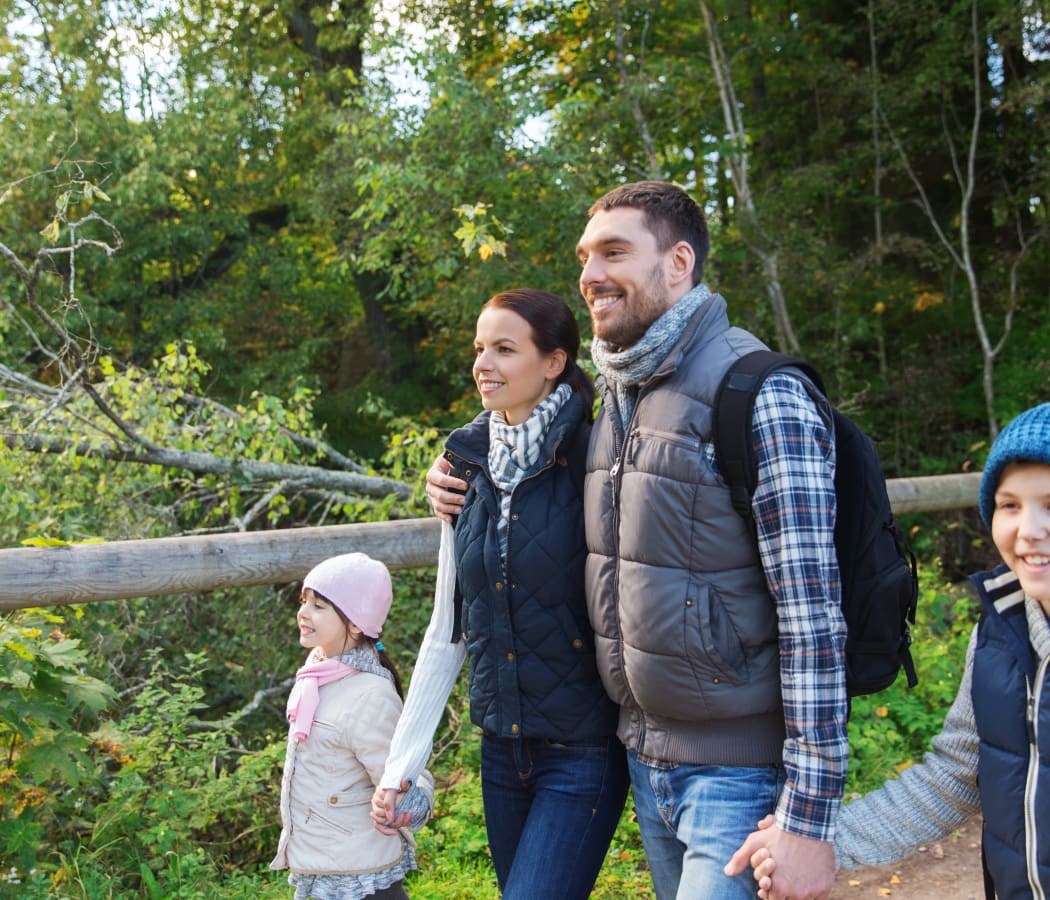 Family walking near President Village in Fall River, Massachusetts