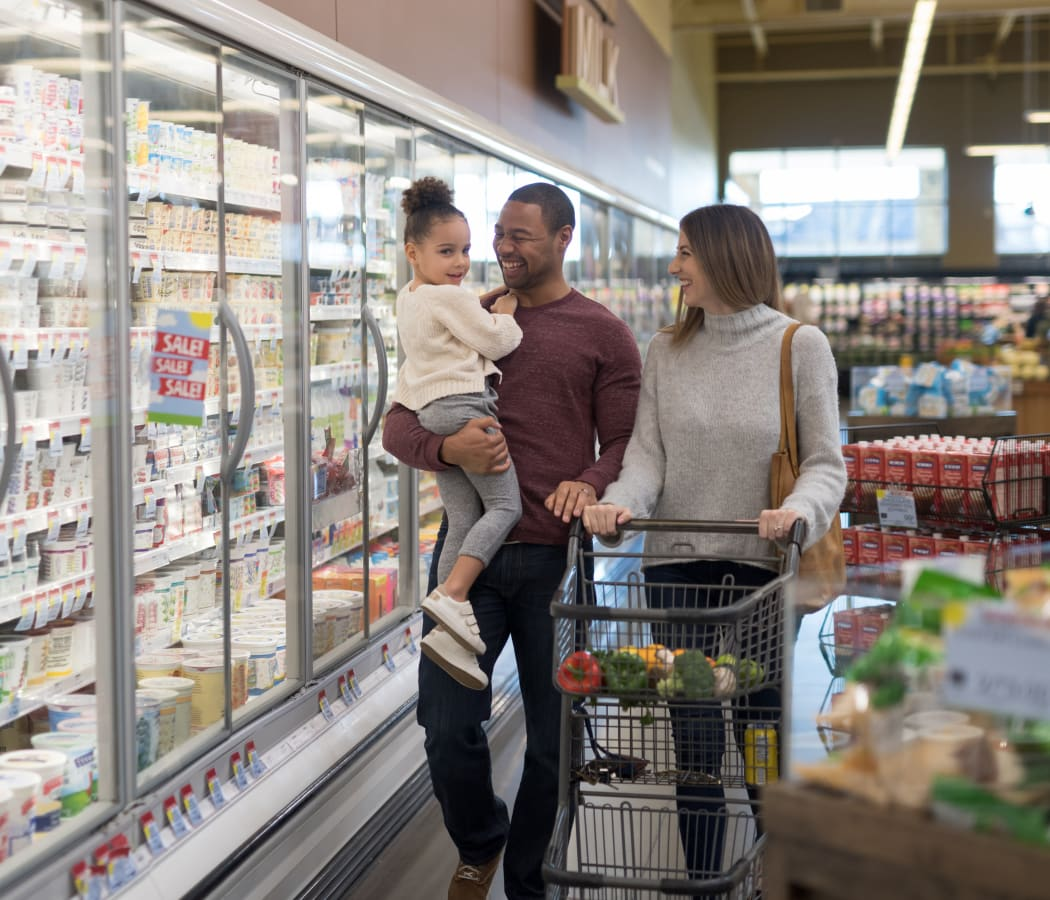 Family shopping at a market near Creekside Place Apartment Homes in Thornton, Colorado
