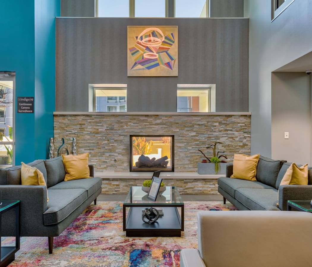 Clubhouse lounge area with a fireplace at Indigo 19 in Virginia Beach, Virginia