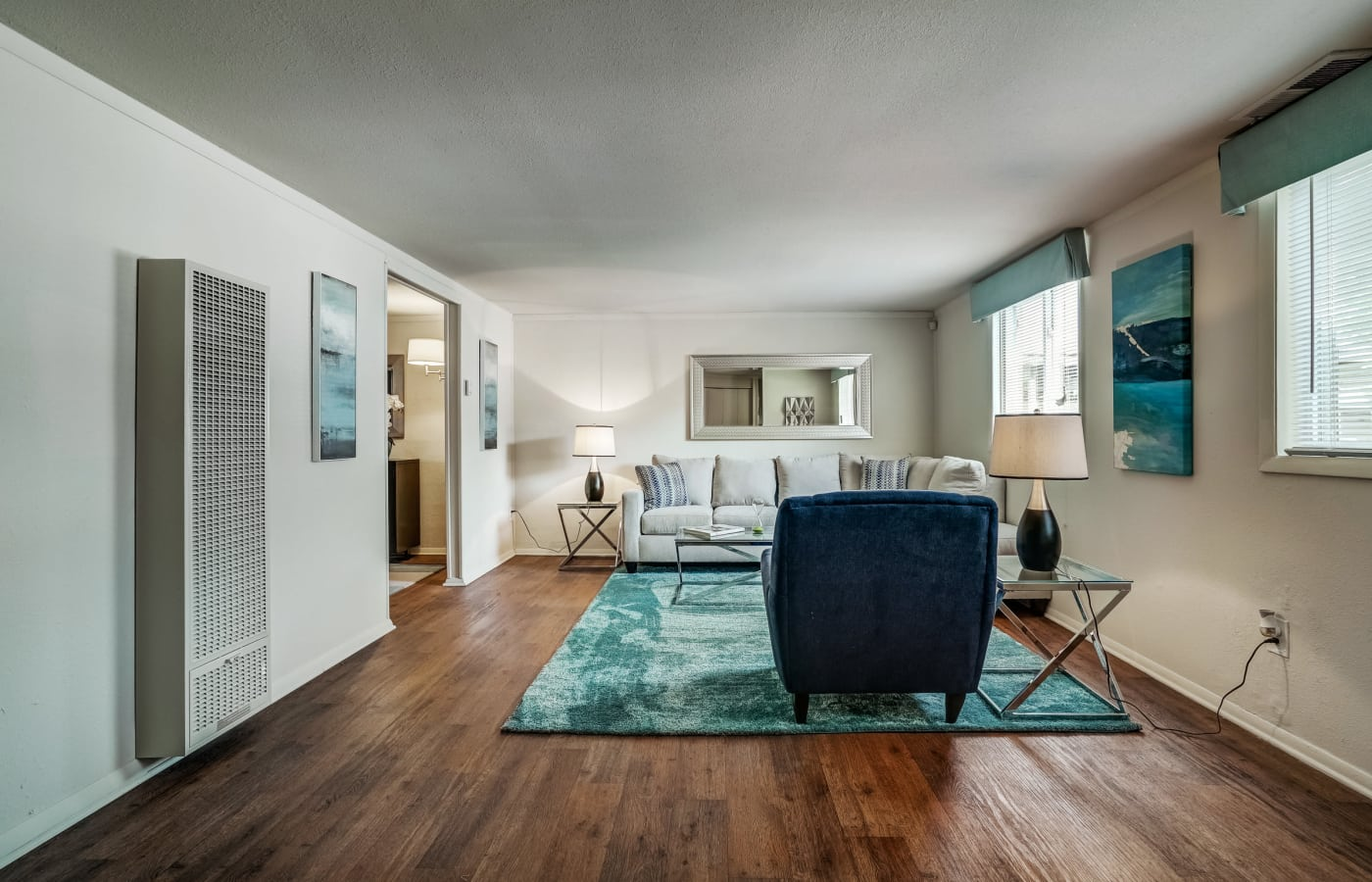 Interior view of model townhome living room with hardwood floors at Avalon Townhomes in Hampton, VA