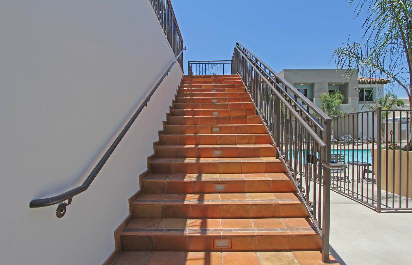 Staircase up to resident clubhouse near the pool at IMT Magnolia in Sherman Oaks, CA