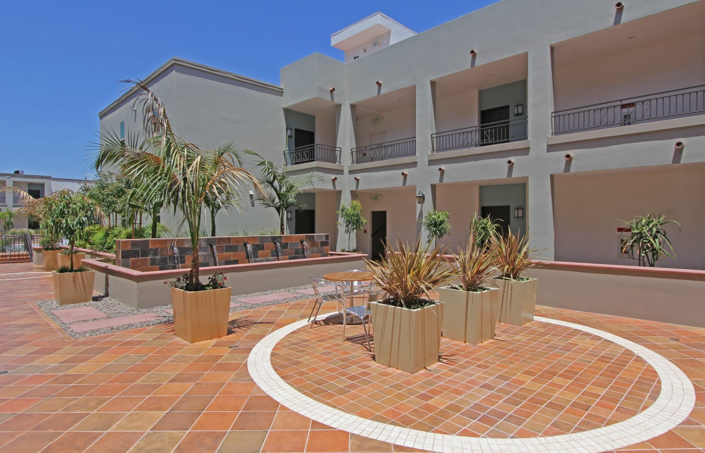 Resident patio with fountains at IMT Magnolia in Sherman Oaks, CA