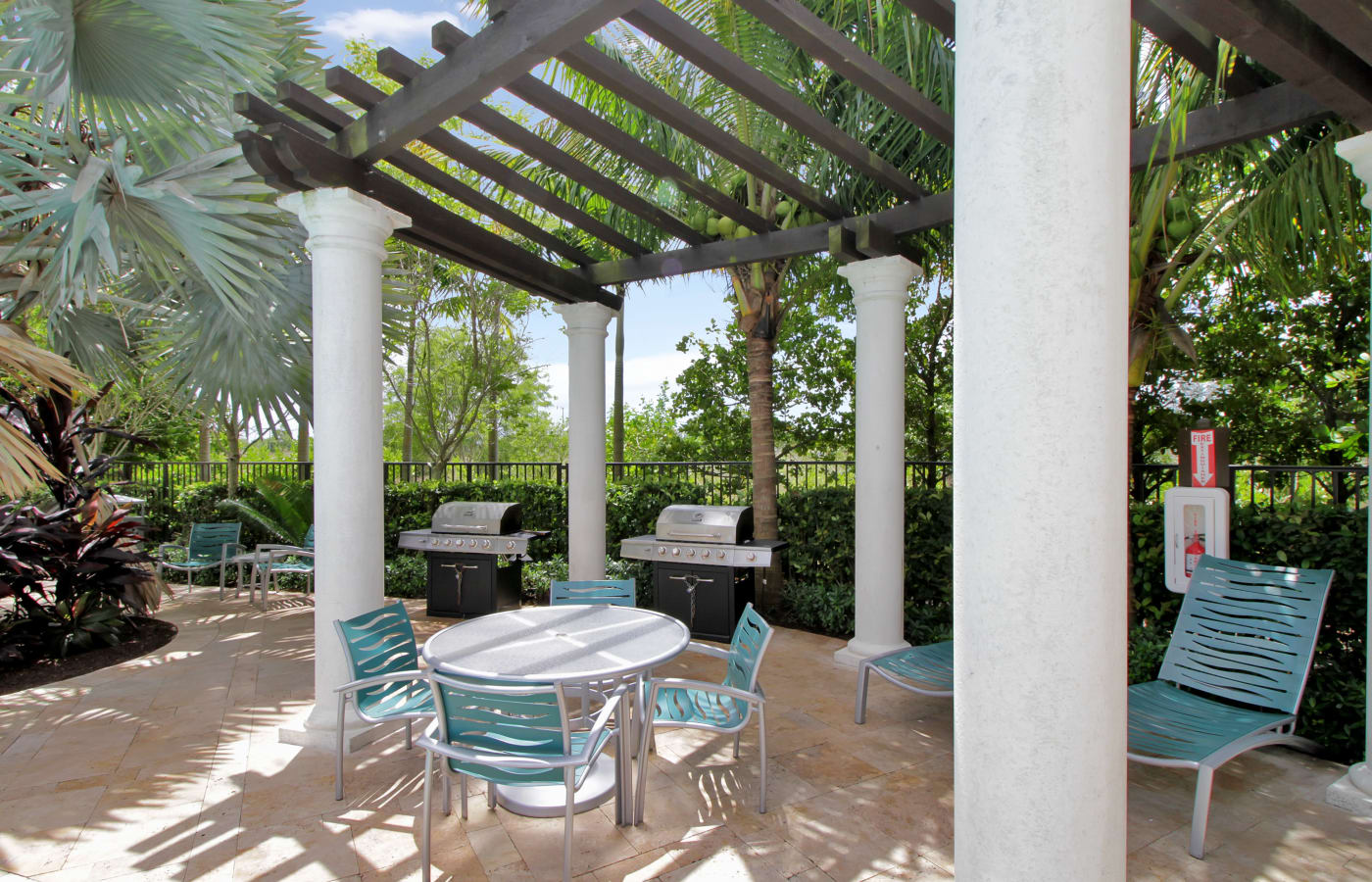 Pergola providing shade for seating area near barbecues at IMT Miramar in Miramar, FL