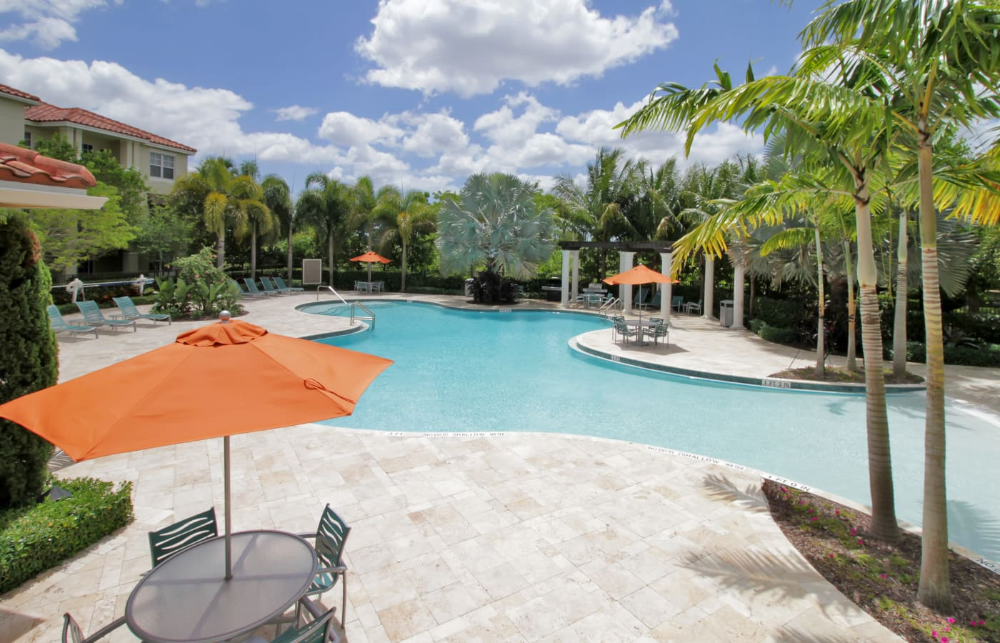 Gorgeous swimming pool area on a beautiful day at IMT Miramar in Miramar, FL