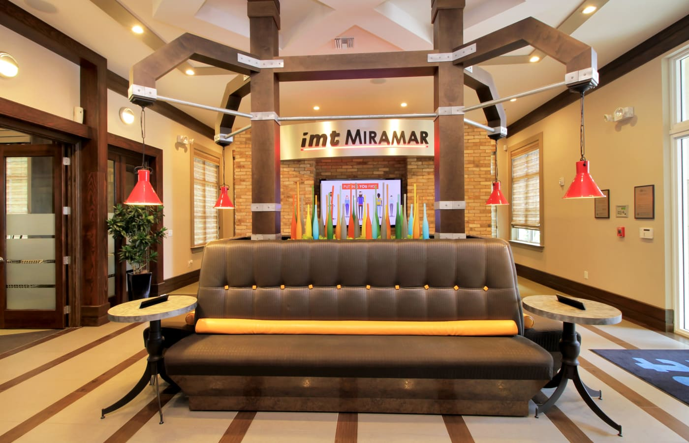 Comfortable seating in the clubhouse at IMT Miramar in Miramar, Florida